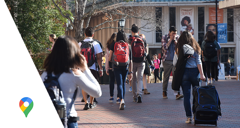 Students walking down a crowded street